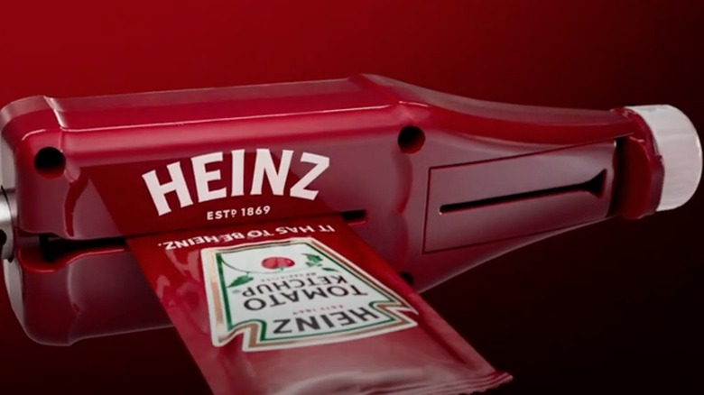 Plastic ketchup packet roller with ketchup packet