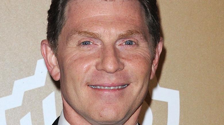 Bobby Flay smiles in headshot