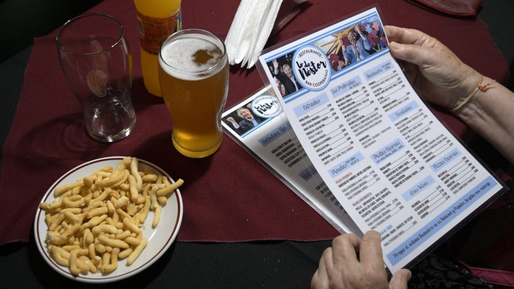 customer holding restaurant menu