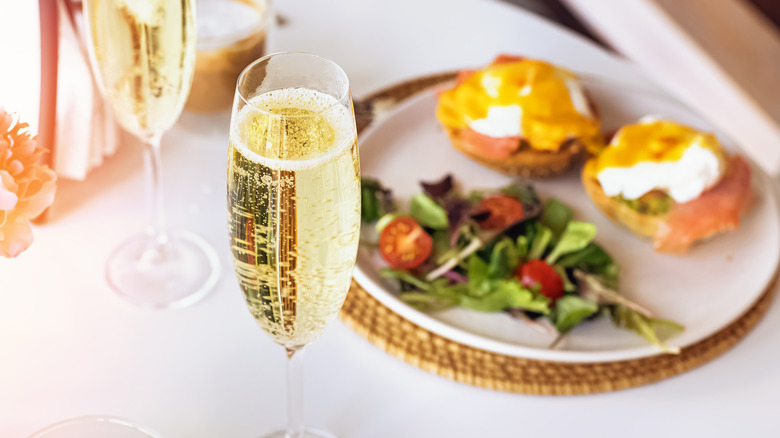 Champagne brunch with eggs Benedict