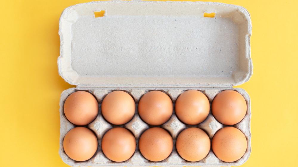Dozen brown eggs in a white carton