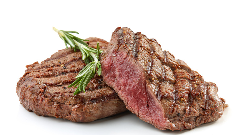 Grilled steak with rosemary sprigs