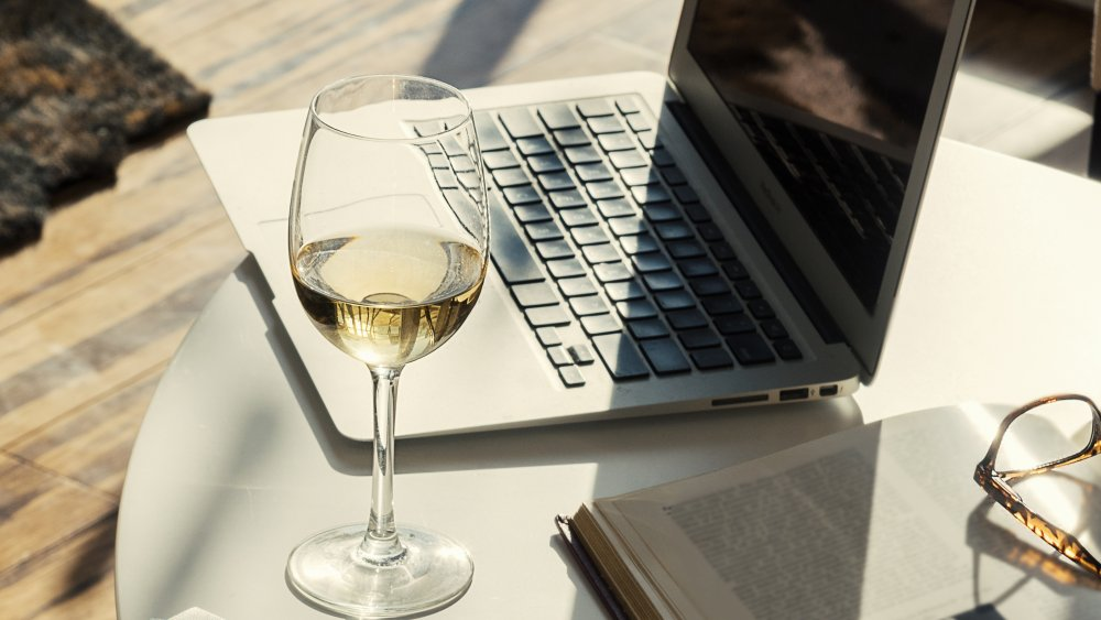 glass of wine with laptop