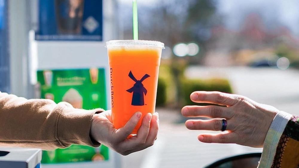 Dutch Bros employee handing drink over