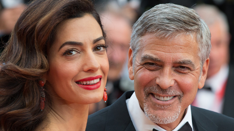 George and Amal Clooney smile