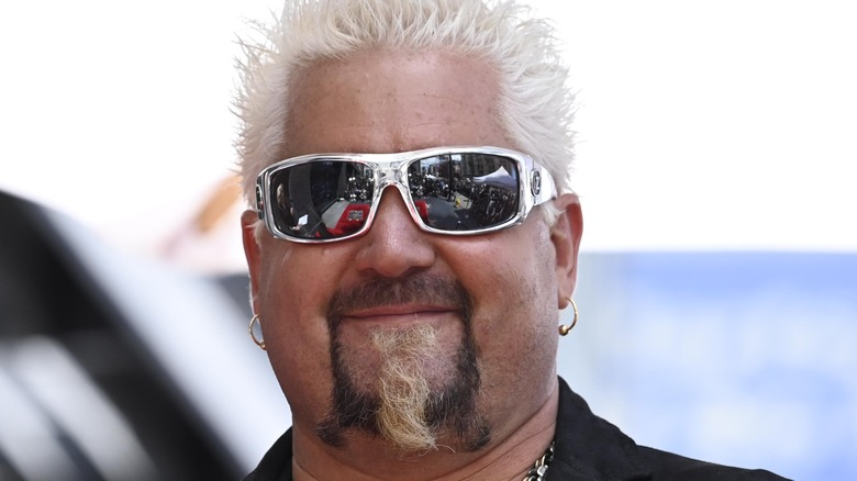 Guy Fieri smiling with sunglasses on