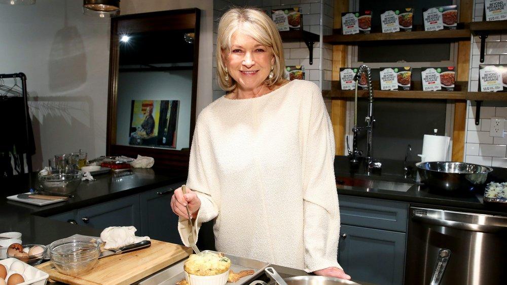 Martha Stewart eating in the kitchen