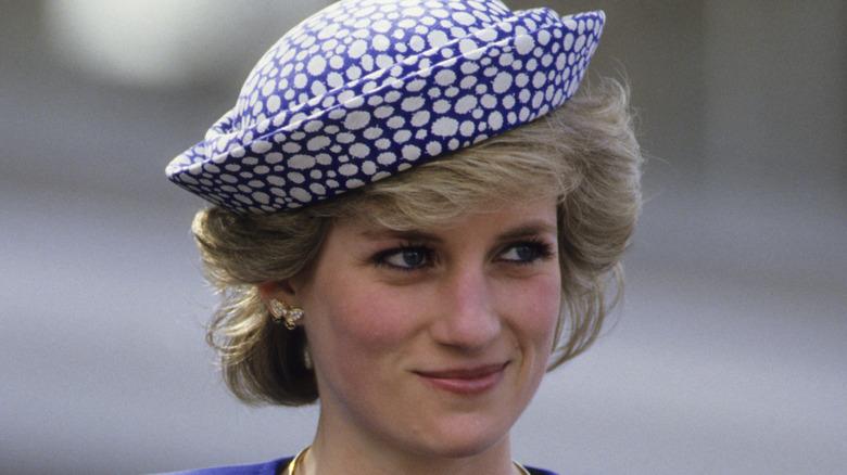 Princess Diana smirking in blue hat