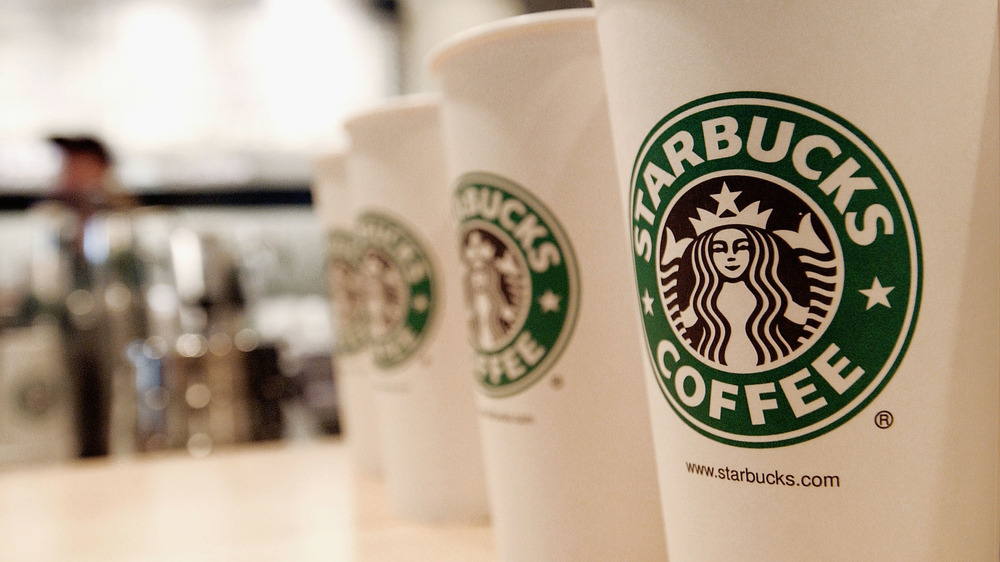 Line of Starbucks takeaway coffee