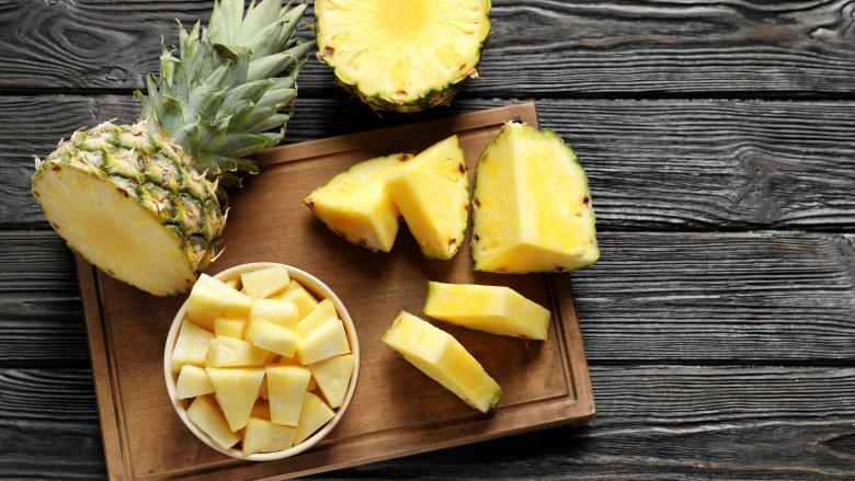 Cut pineapple on cutting board