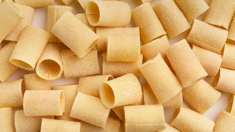 Paccheri pasta on a white surface