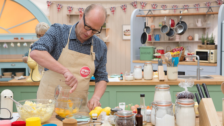Contestant baking on Bake Off
