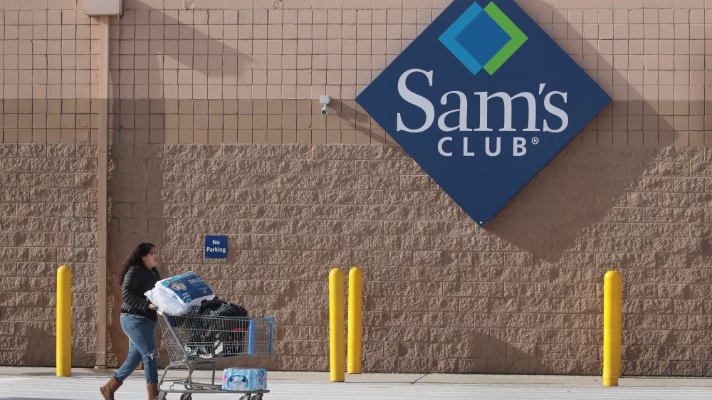 person with cart outside a Sam's Club