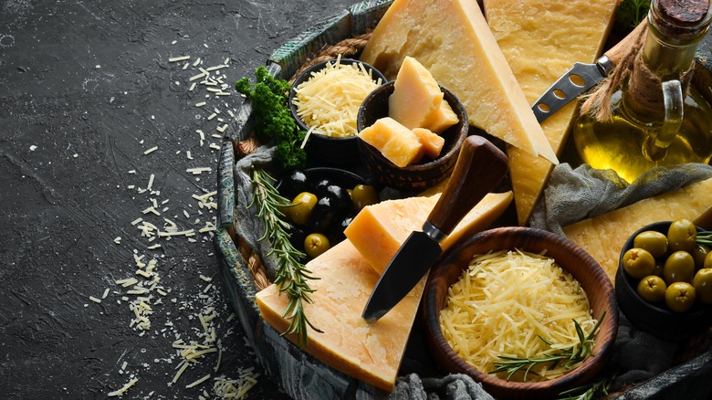 Parmesan wedge other cheeses with olives