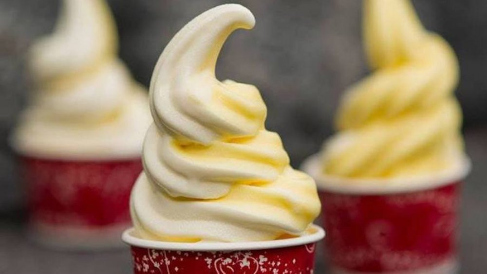 soft serve dole whip with swirl in red cup