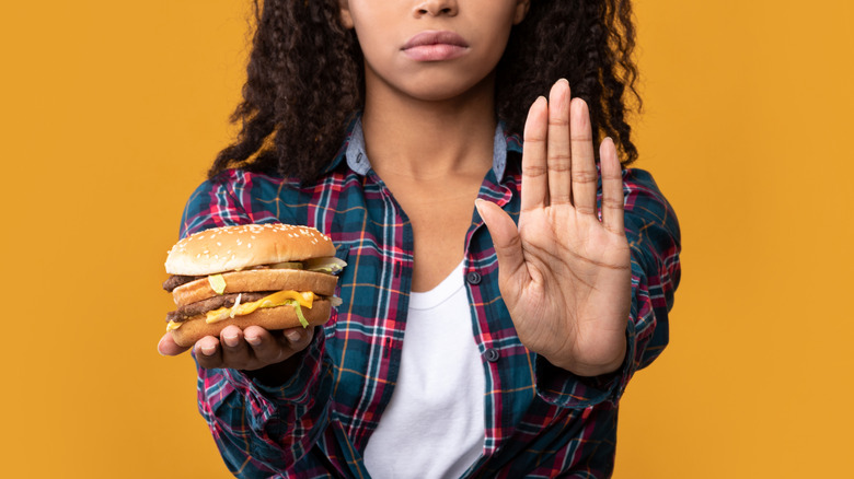 Woman holding bad burger