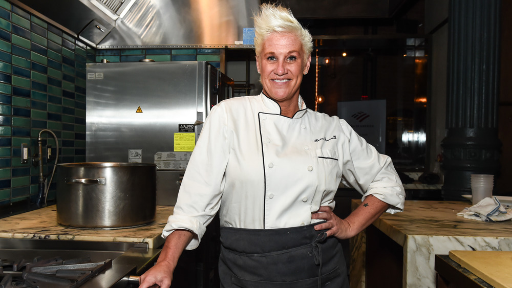 Anne Burrell standing a kitchen