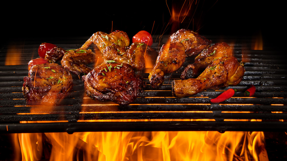 Chicken legs and thighs on a grill rack
