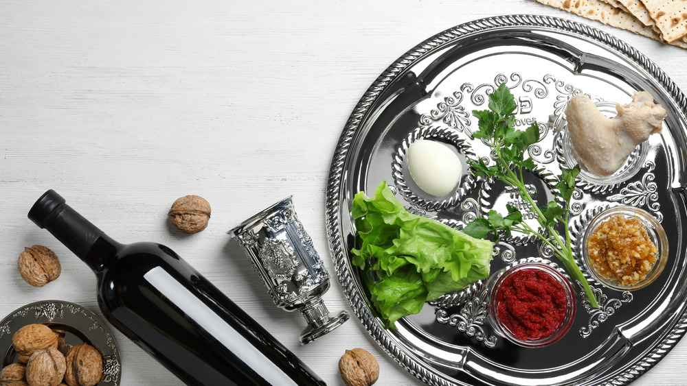 Silver Seder plate with decorative scrollwork