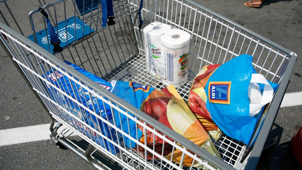 Shopping cart at Aldi with plastic bags