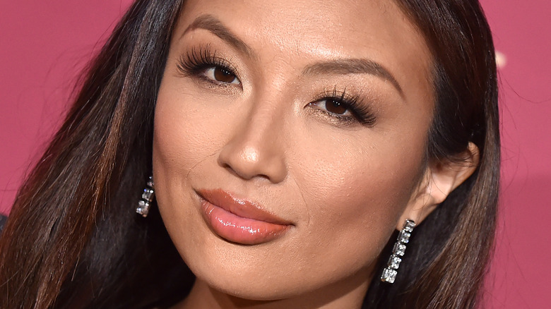 Jeannie Mai posing on the red carpet