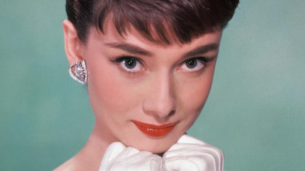 Audrey Hepburn poses in gloves