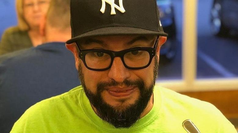Carl Ruiz in hat and glasses