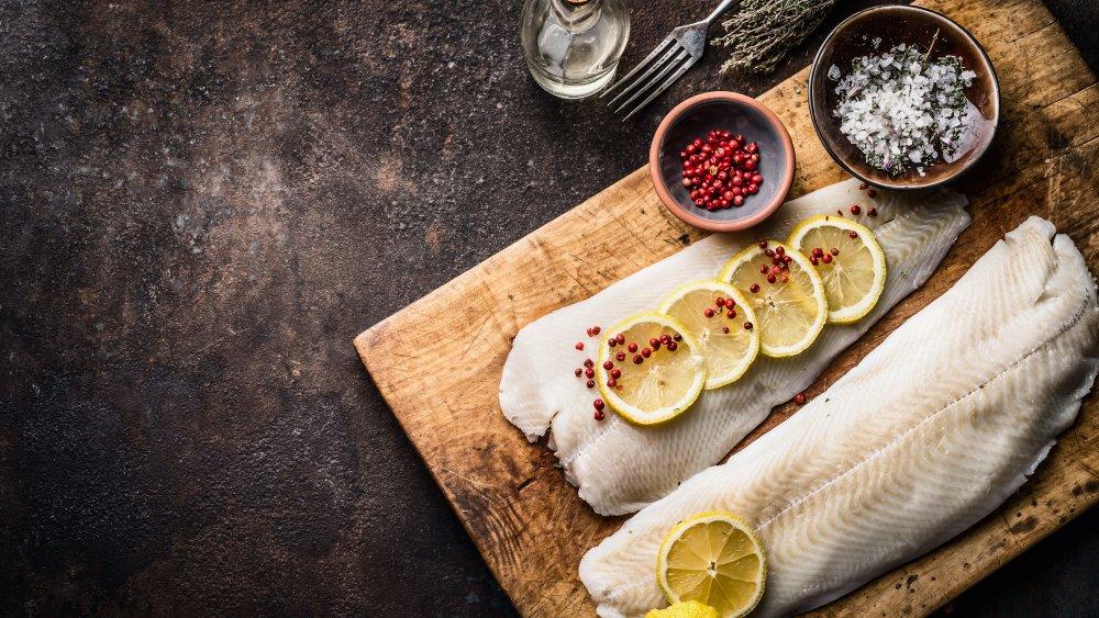 Raw cod filet with seasoning