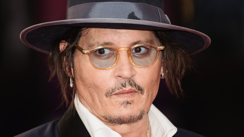 Johnny Depp in hat and glasses