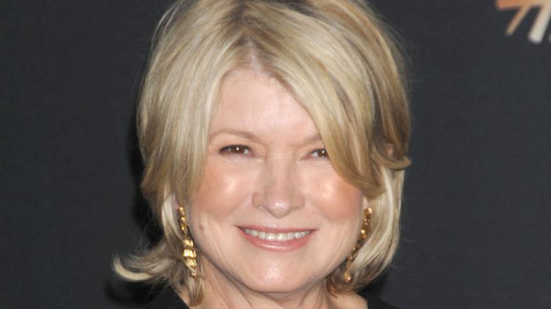 Martha Stewart wearing gold earrings