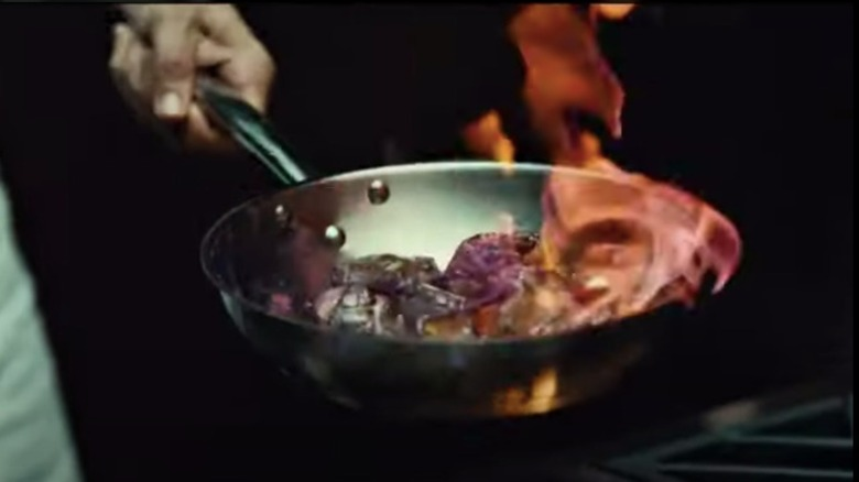 A screenshot from Hannibal of pan over flame