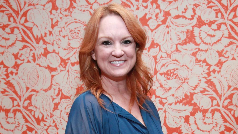 Ree Drummond in front of orange wallpaper