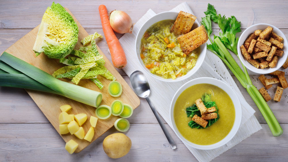 Savory cabbage soup in white bowls