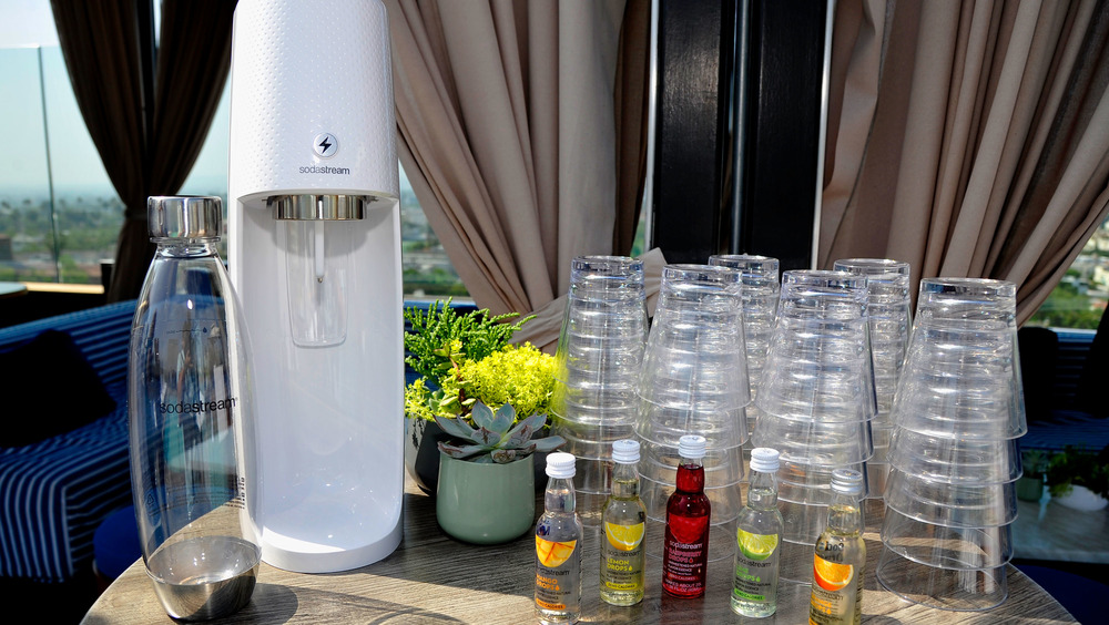 SodaStream with glasses and bottles