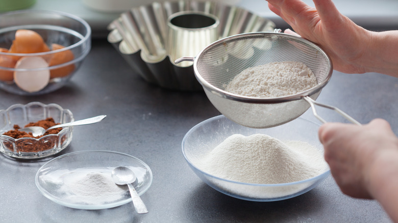 sifting flour for baking a cake