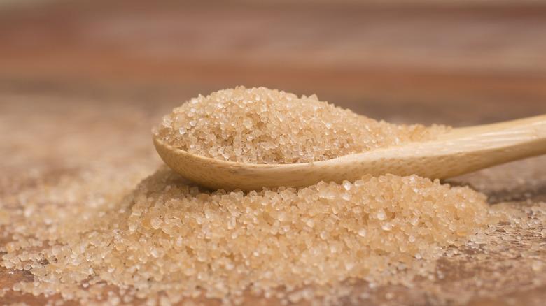 Demerara sugar on a wooden spoon