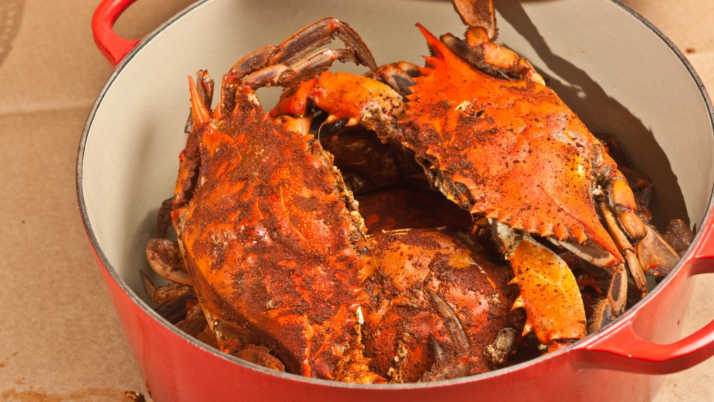 Chesapeake Bay blue crabs in a pot with Old Bay seasoning