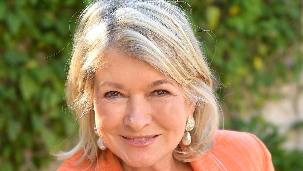 Martha Stewart in orange blazer