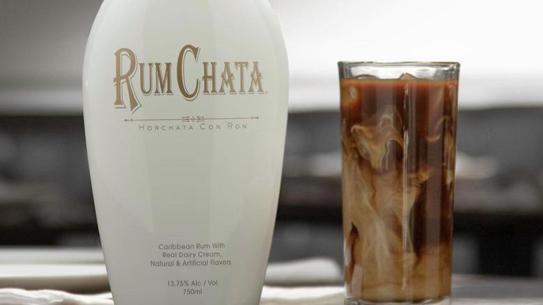 RumChata bottle next to glass