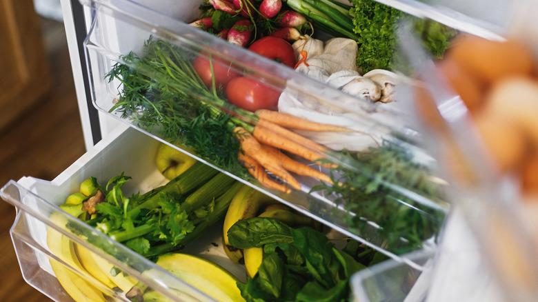 Two crisper drawers inside a refrigerator