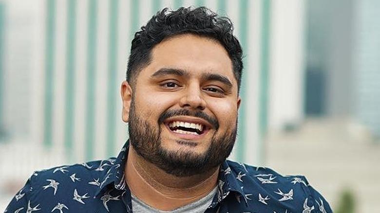 El Guzii, Gustavo Figueroa, smiling outside