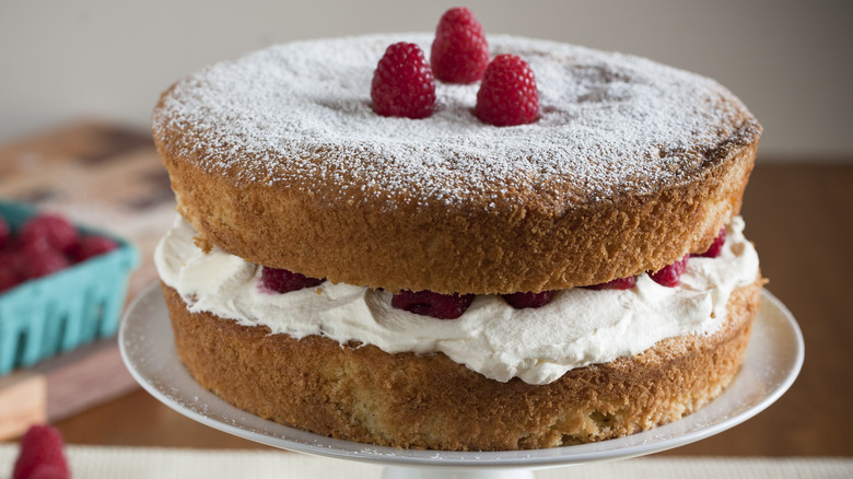 Two layer cake with berries and cream