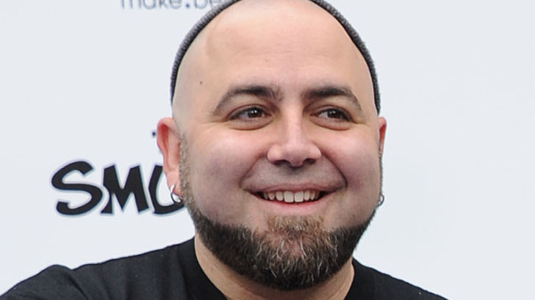 Duff Goldman in a cap and grinning