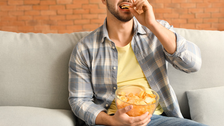 Person eating chips