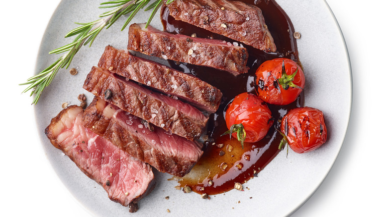 Grilled steak with tomatoes