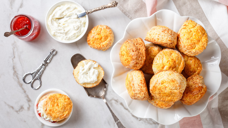 A bowl of scones with jam and clotted cream