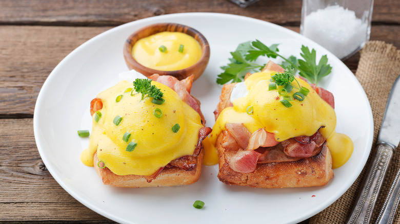 Eggs Benedict with a side of hollandaise