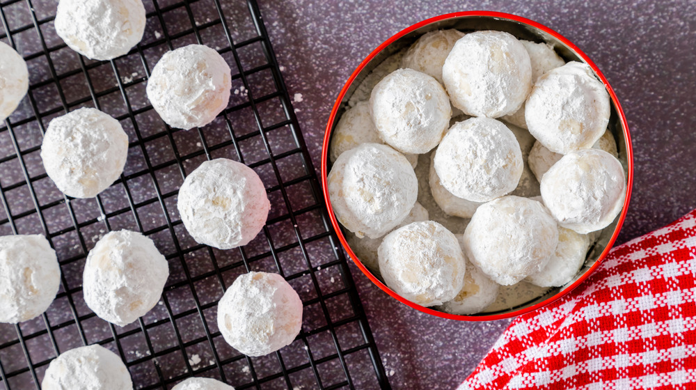 Mexican wedding cookies in a tin