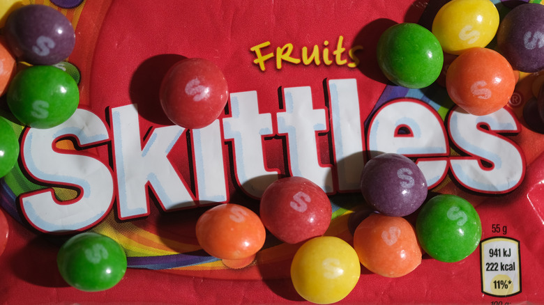 A pack of skittles with candies