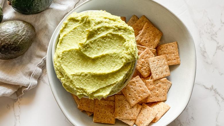 avocado hummus dip with crackers
